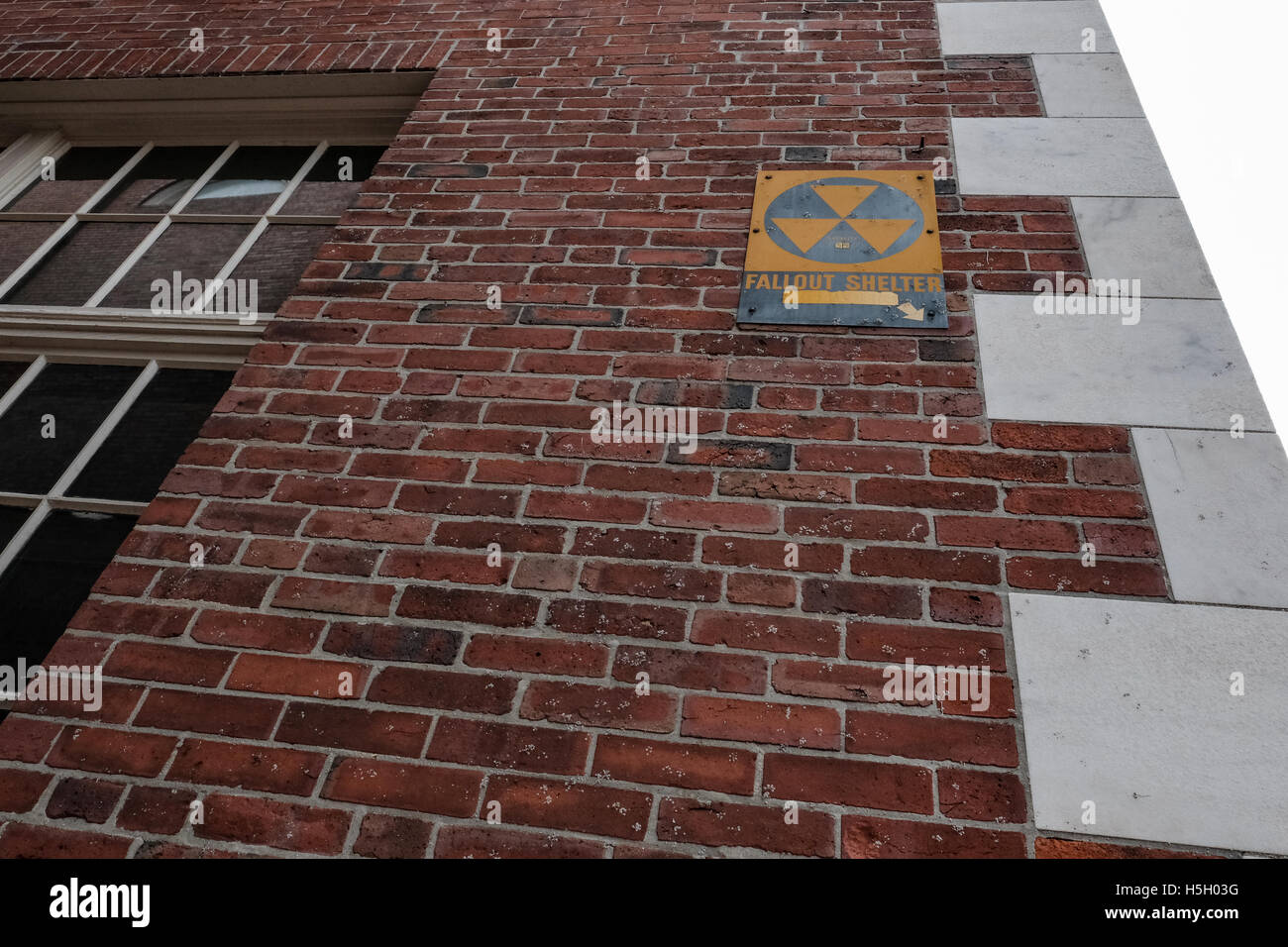Vintage Nuclear Fallout sign seen on an old government building in Salem, MA, USA. - Stock Image