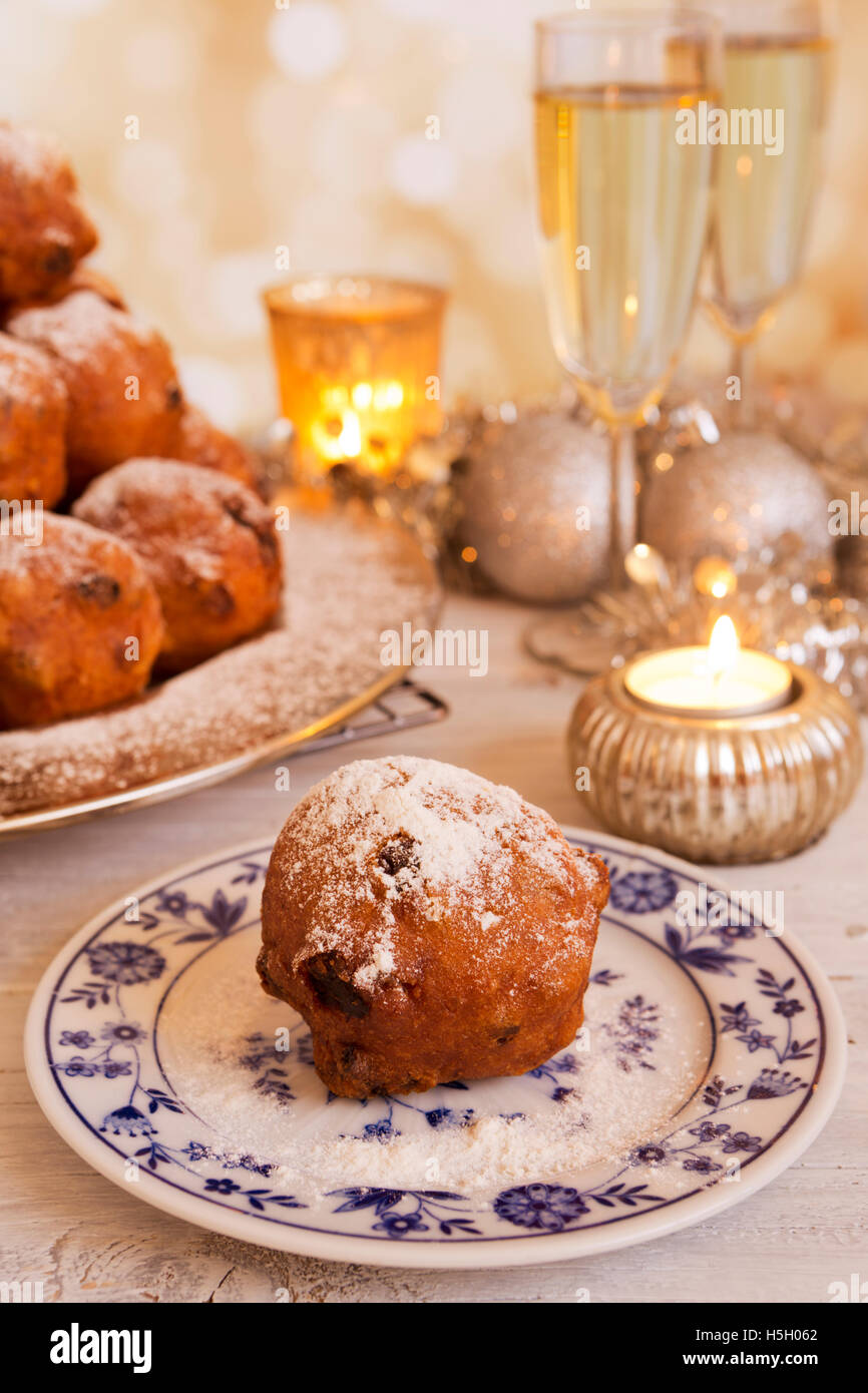 Champagne and 'Oliebollen', traditional Dutch pastry for New Year's Eve. - Stock Image