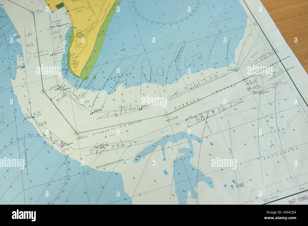 Admiralty navigation chart in ship's chartroom - Stock Image