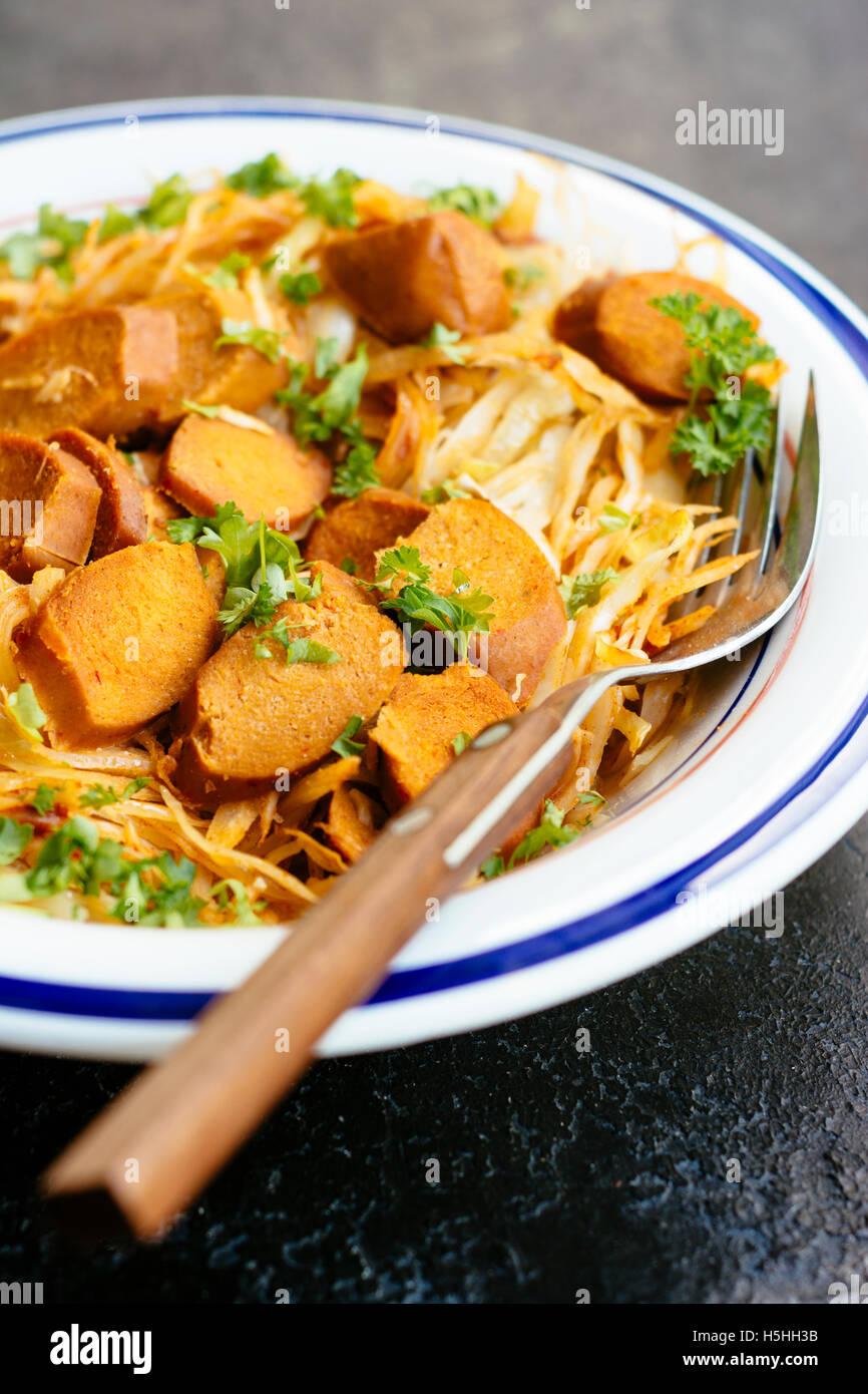 Smoky Cabbage with Tofu Sausage - Stock Image
