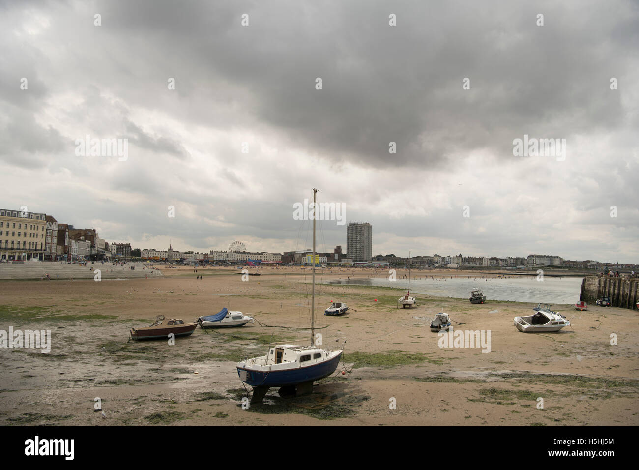 Tide out in Margate Harbour - Stock Image