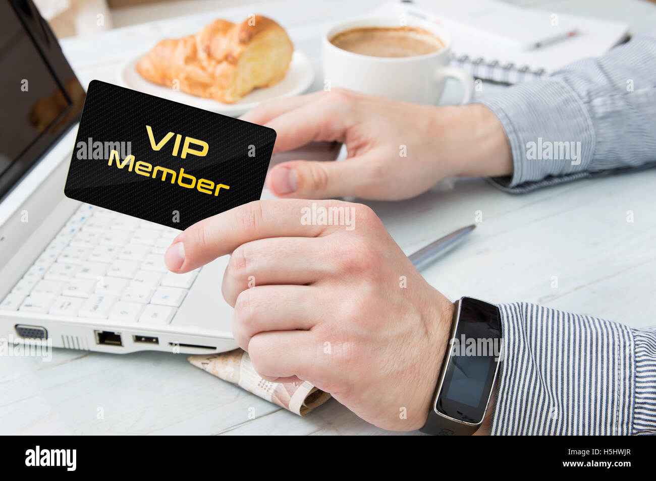 Man uses VIP member card on the internet - Stock Image