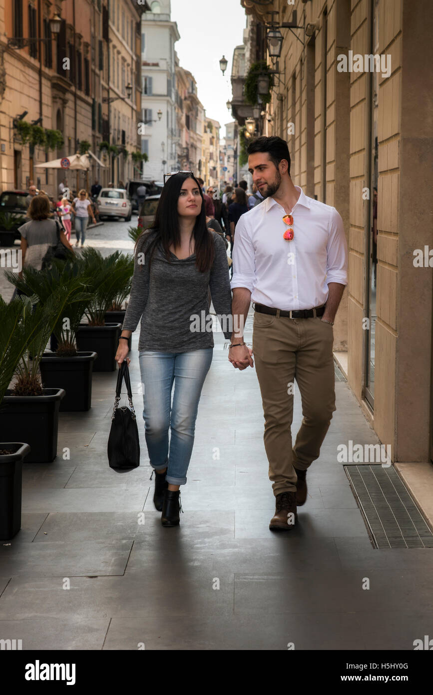 Caucasian young tourist couple walking in the street, Rome, Lazio, Italy - Stock Image