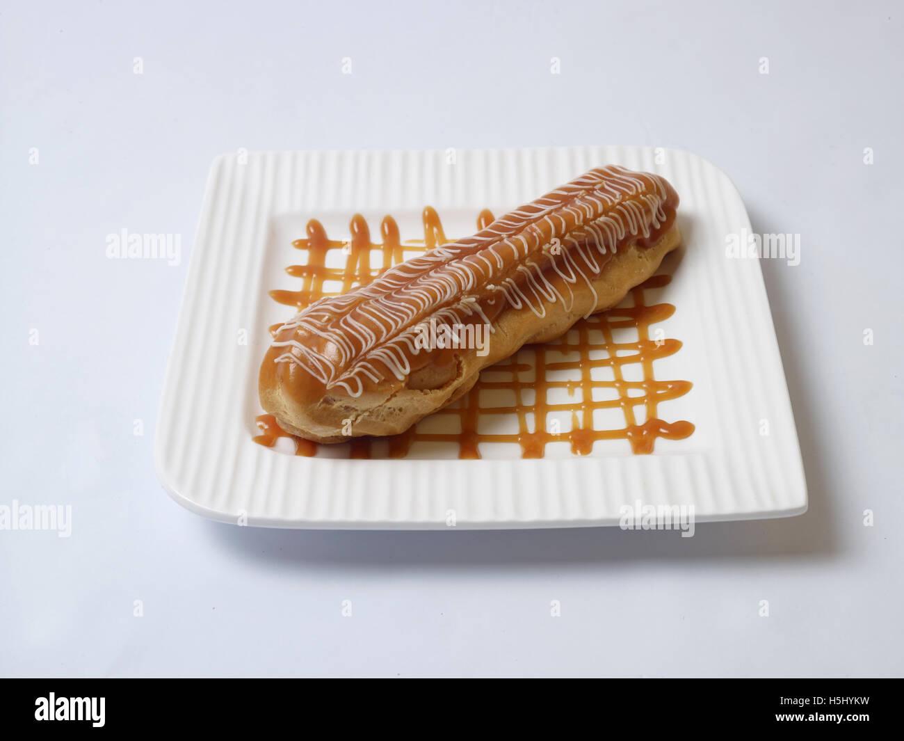 caramel eclair - Stock Image