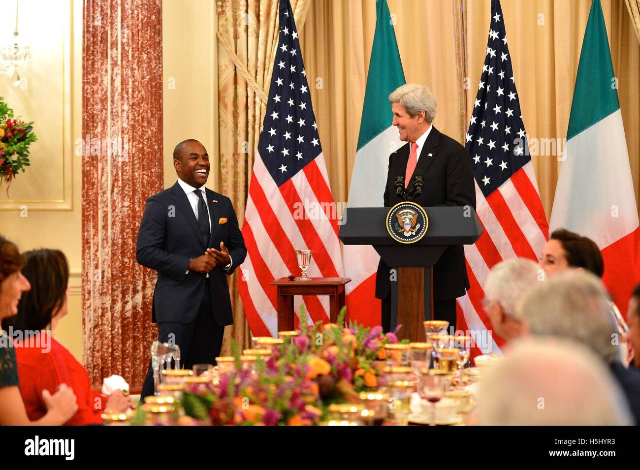 U.S. Secretary of State John Kerry applauds opera singer Lawrence Brownlee after his performance at the State Luncheon - Stock Image