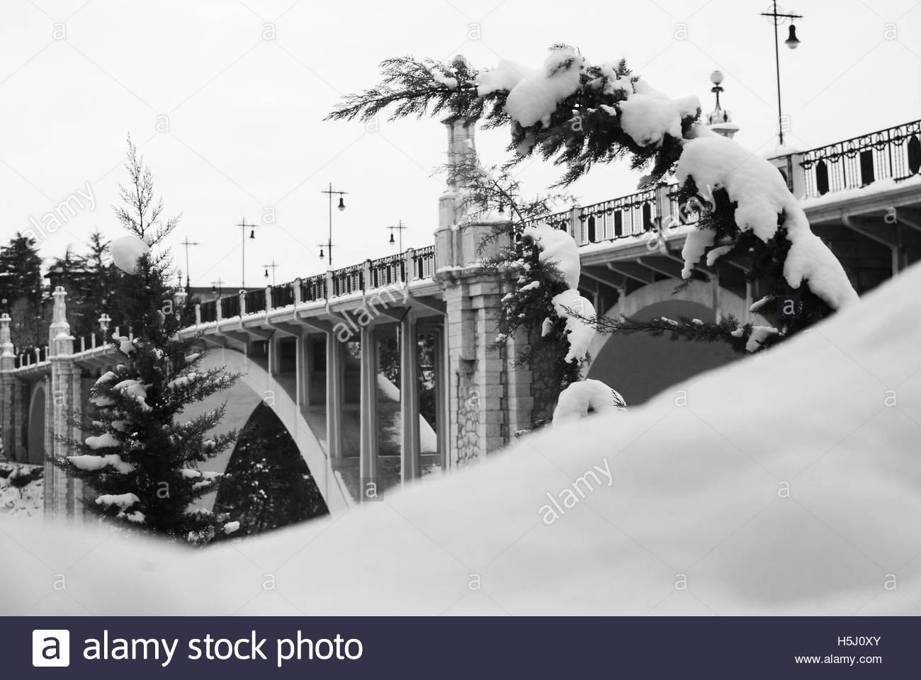 Stone bridge of Teruel, Spain,  with snow - Stock Image