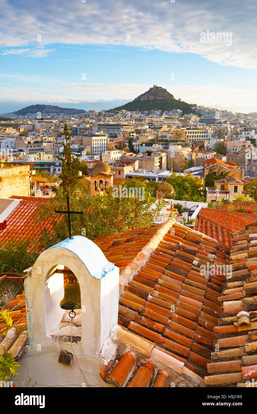 Lycabettus hill and a small Greek orthodox church in Anafiotika, Athens. - Stock Image