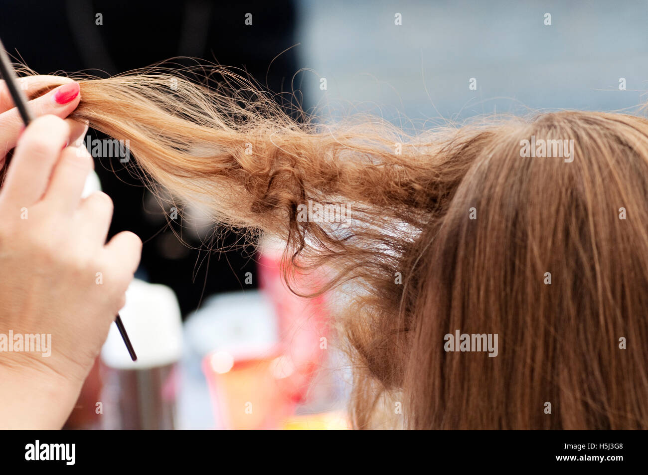 Female Client Having a Blow Dry in a Hairdressing Salon - Stock Image