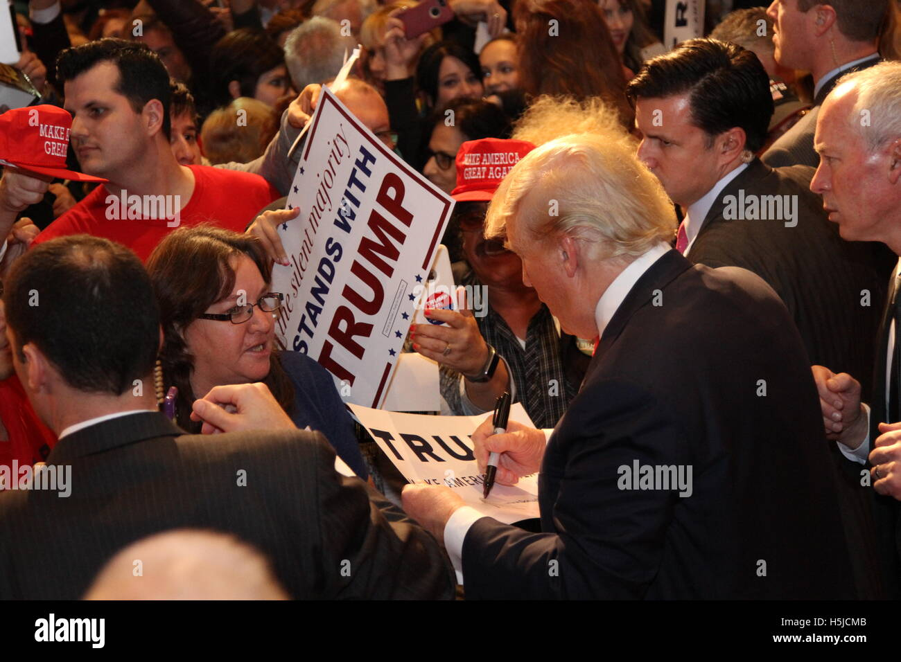 Donald J Trump signing autographs for his supporters at his Donald J Trump for President rally at the South Point - Stock Image
