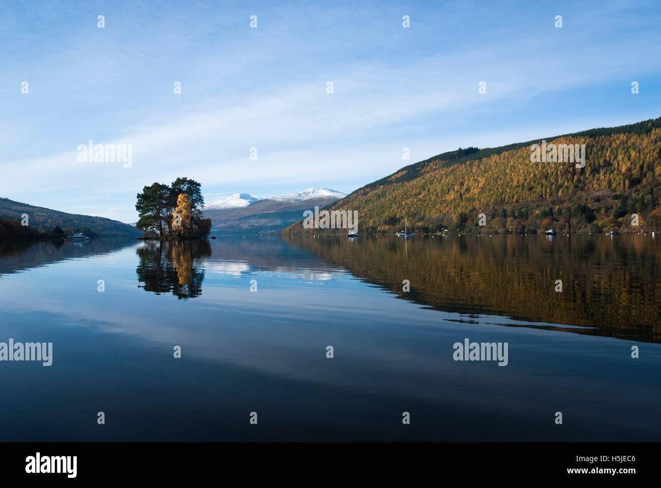 A autumnal looking landscape image of Loch Tay and the Isle of Spar with Ben Lawers in the background. Stock Photo