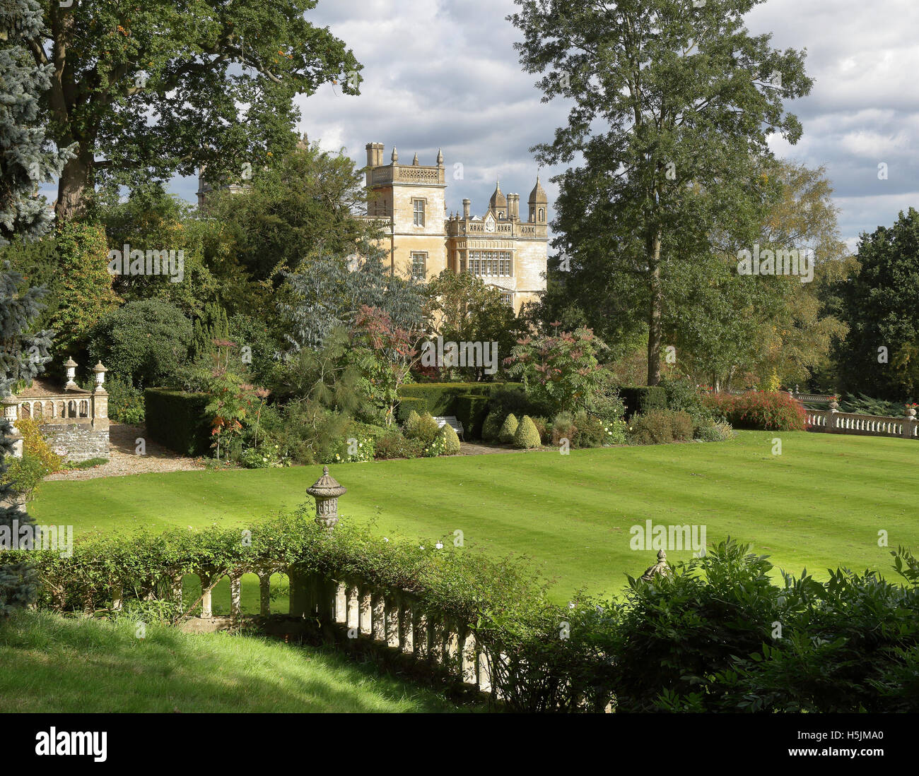 An English Formal Landscape garden and stately home with balustrades - Stock Image