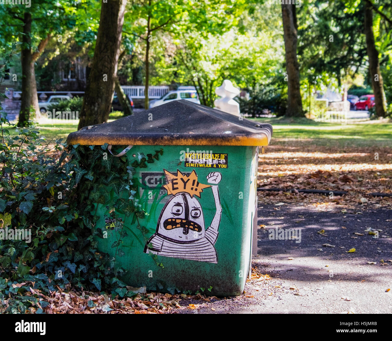 Darmstadt, Hesse, Germany. Graffiti on trash can in park Stock Photo
