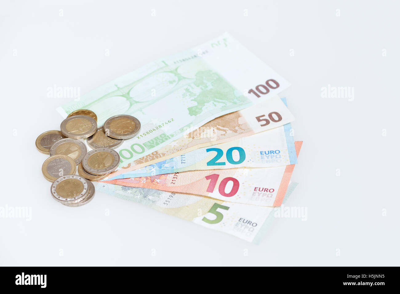 Different kind of Euro bills and coins - Stock Image