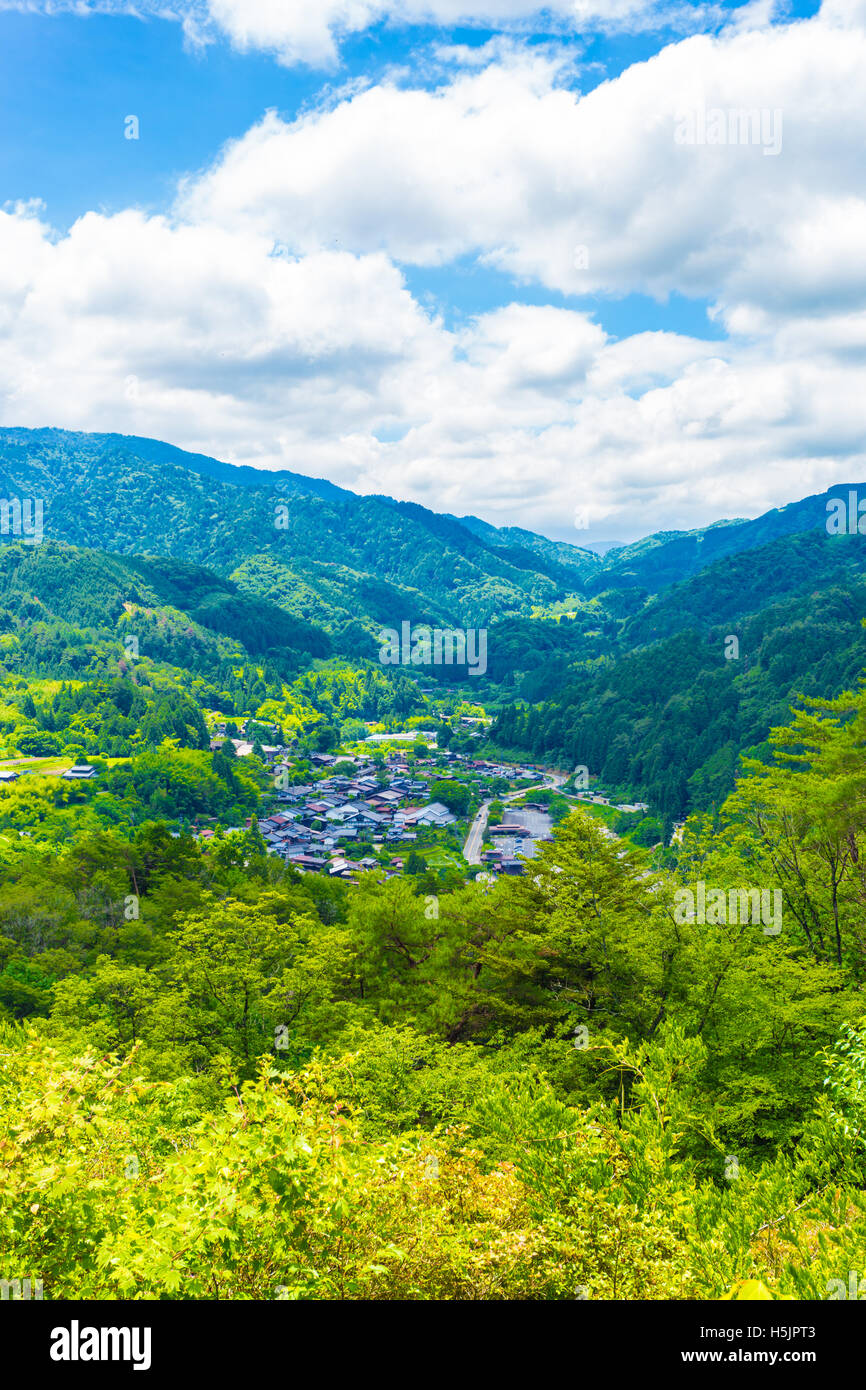 A view from high angle viewpoint and former grounds of Tsumago castle overlooking Tsumago village above the Magome - Stock Image