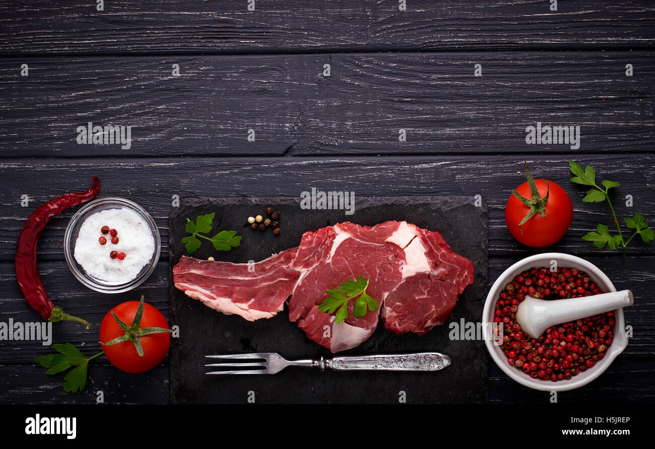Raw meat steak entrecote. Selective focus, top view, space for text Stock Photo