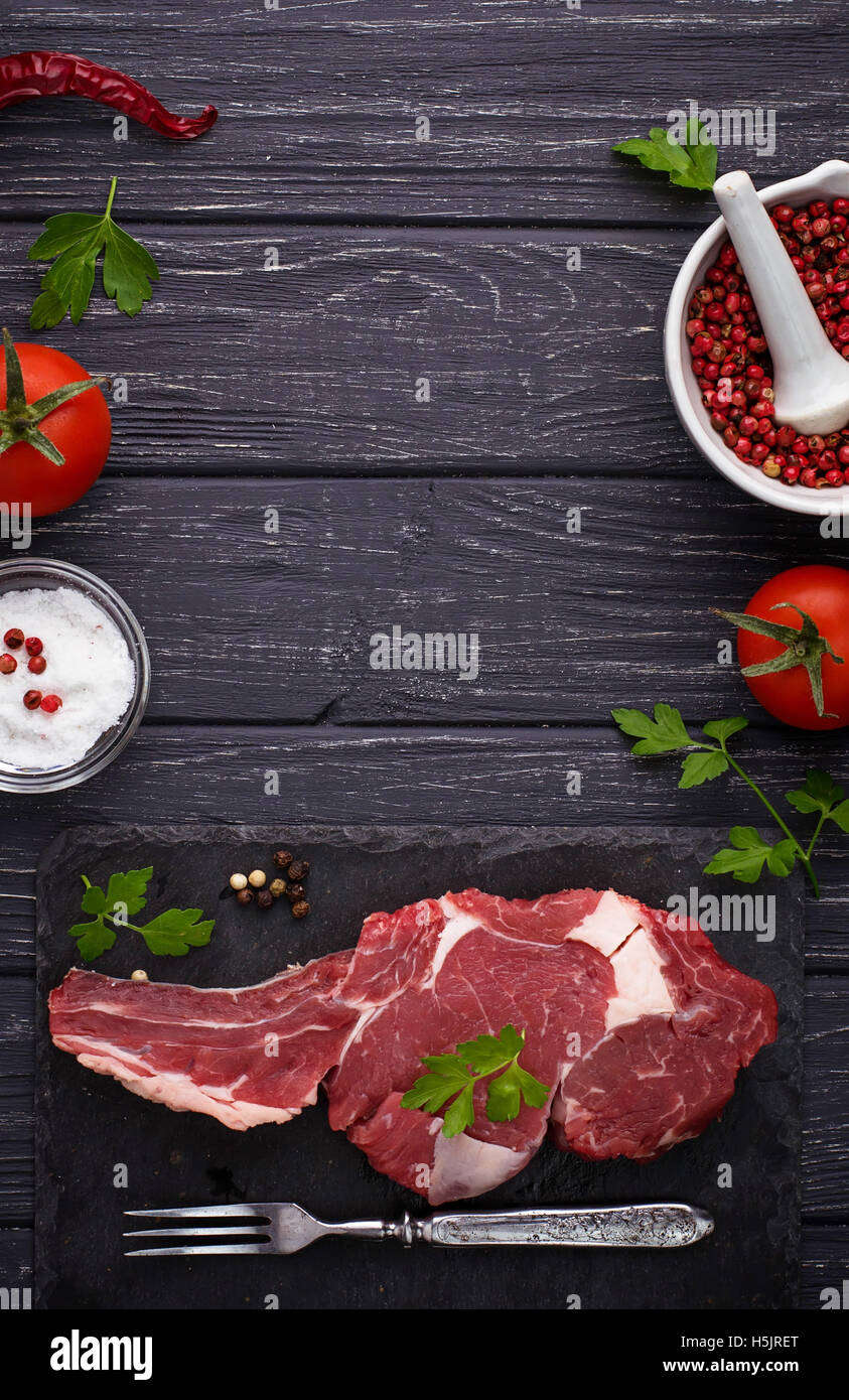Raw meat steak entrecote. Selective focus, top view, space for text - Stock Image