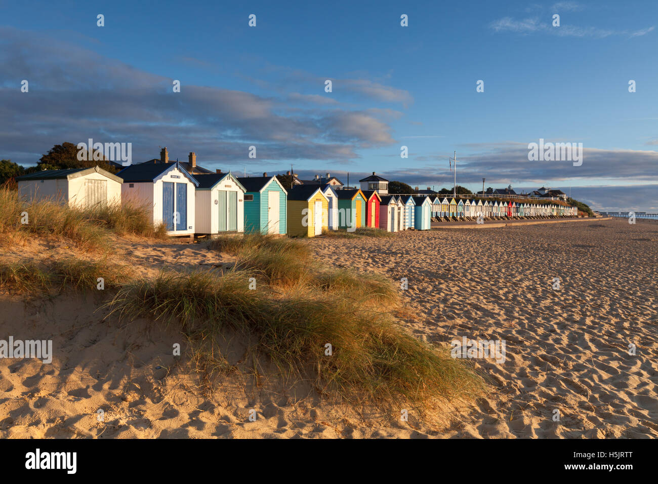 Beach Huts and prom at Southwold Suffolk - Stock Image