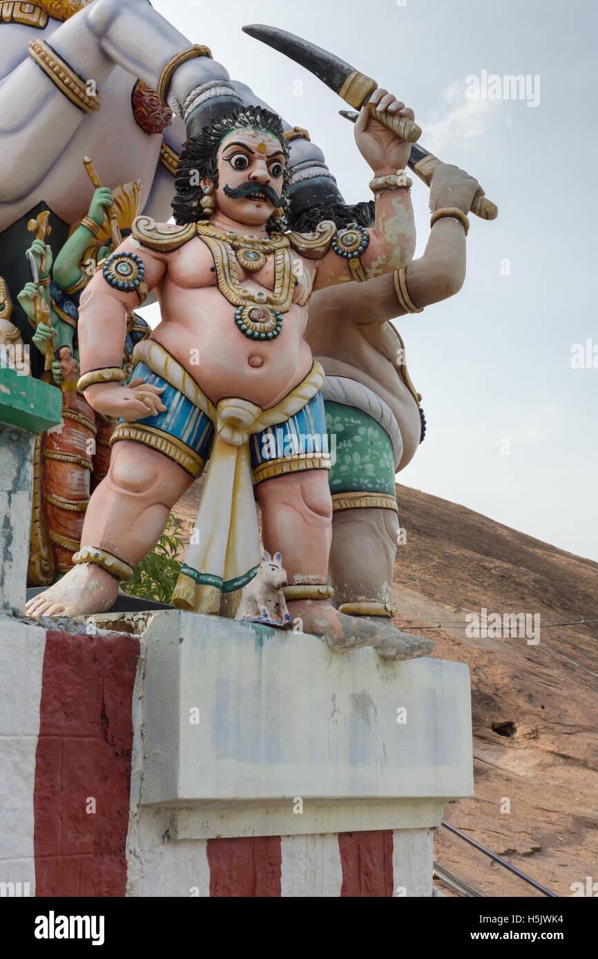 Closeup of belligerent Karuppana Sami deity. - Stock Image
