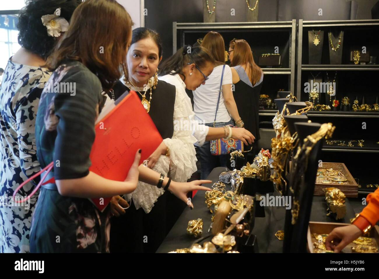 Pasay, Philippines. 20th Oct, 2016. Ann Ong a fashion accessories designer in her booth 'Ann Ong: Definitive - Stock Image