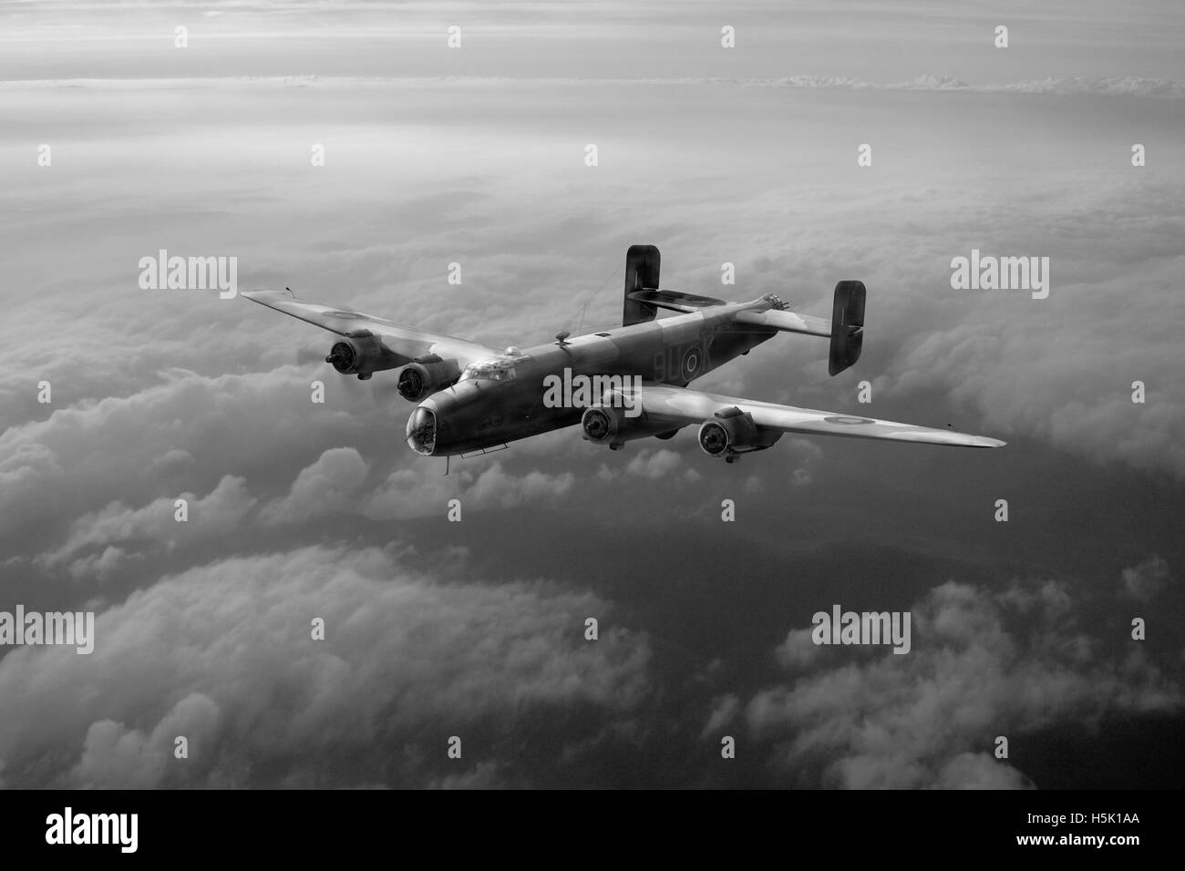 A solitary RAF Handley Page Halifax Mk III makes its way back to its base in the south of England in 1944. - Stock Image