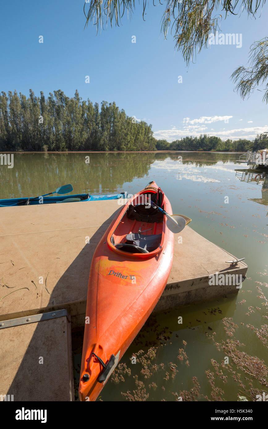 Canoes moored at a pontoon in the River Murray near Wilkadene Australia - Stock Image