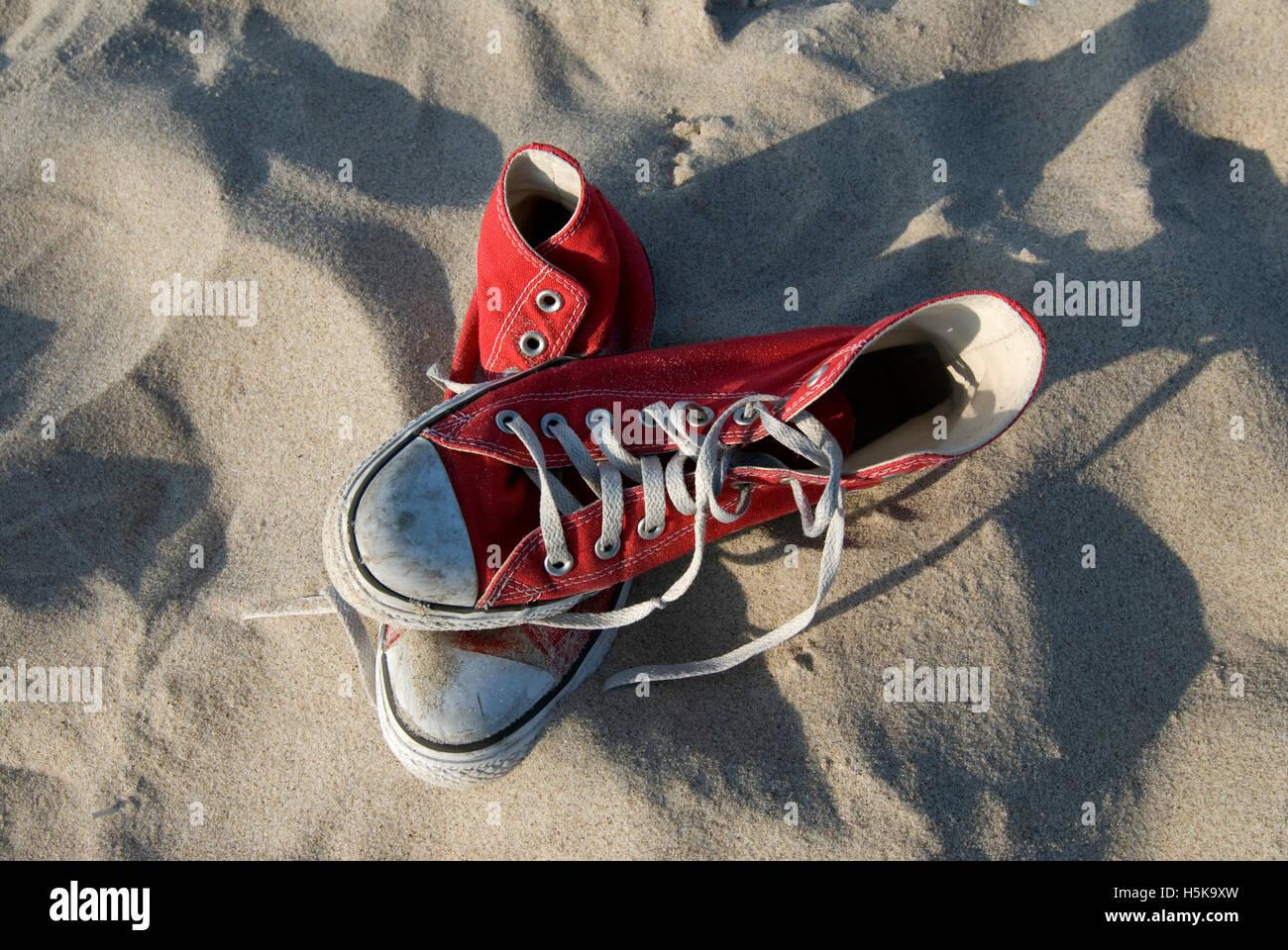 d9c577edef9 Red Converse Chuck Taylor All Star shoe pair. CRWJAA (RM). Red Converse   Chucks
