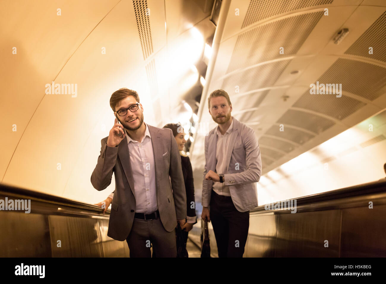 Business people using subway to get to meeting - Stock Image