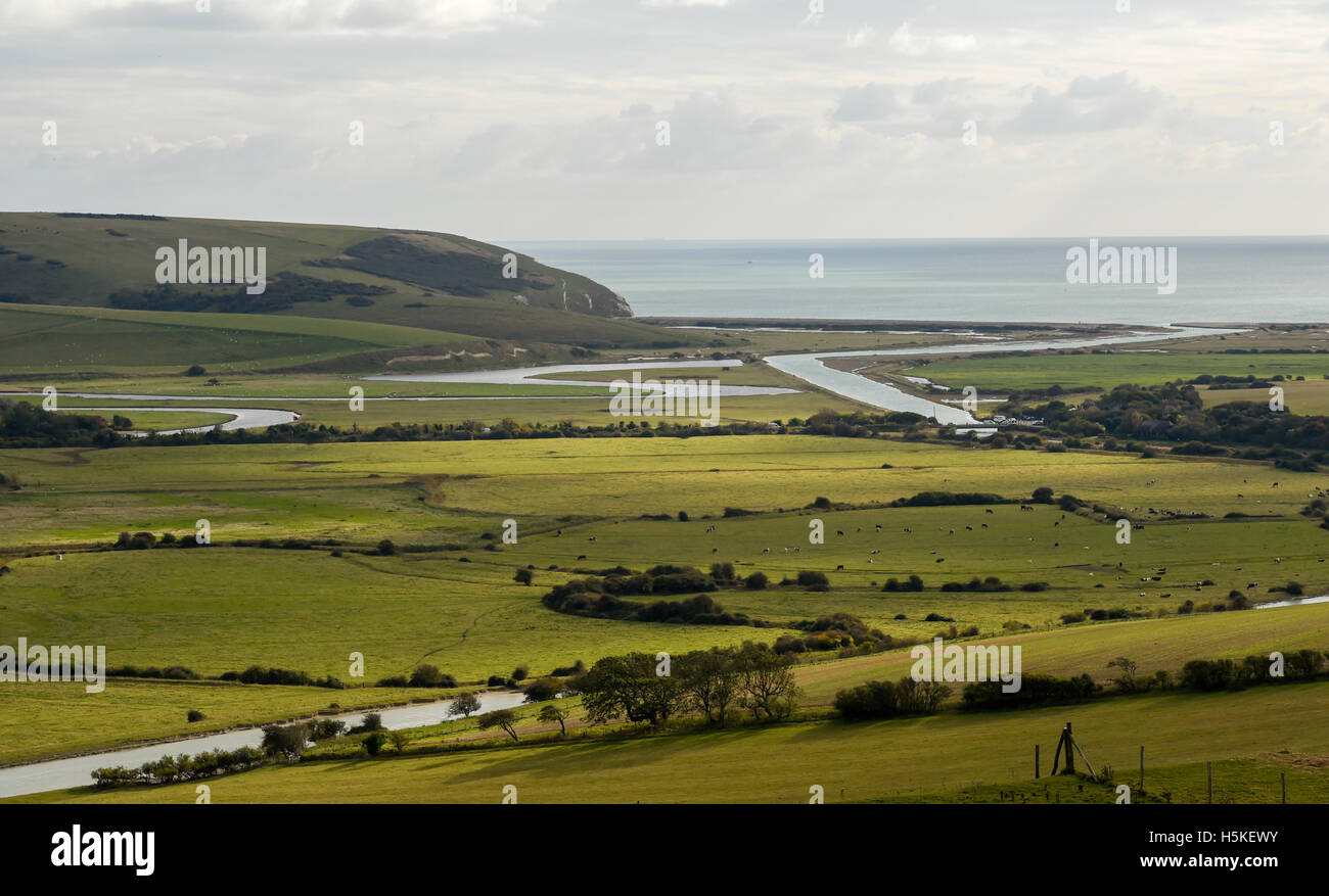 Cuckmere Haven lies on the coast and is an area of flood plains where the South Downs meets the sea in East Sussex Stock Photo