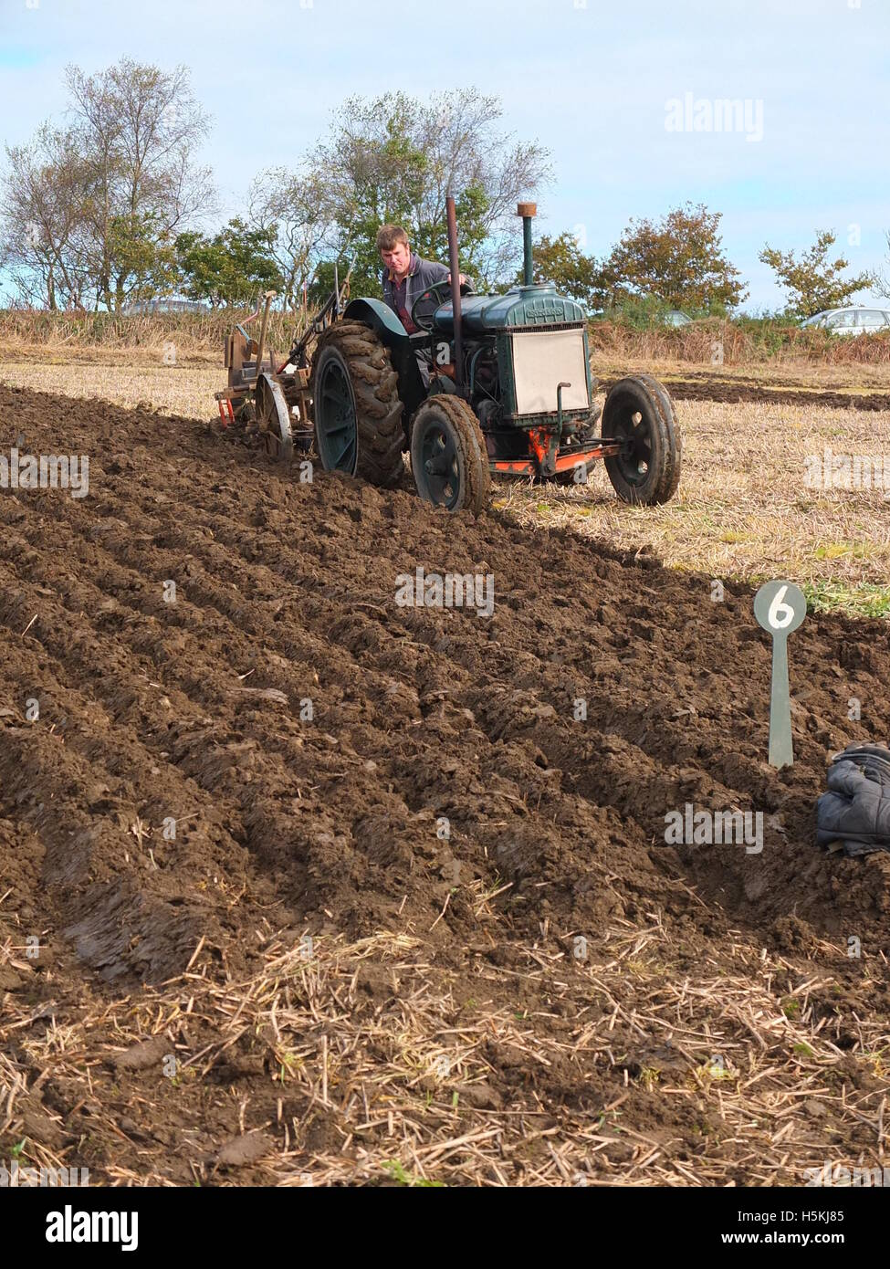 Farmer inspects his ploughing at Ashover Ploughing Match, Highoredish Farm, Derbyshire. Stock Photo