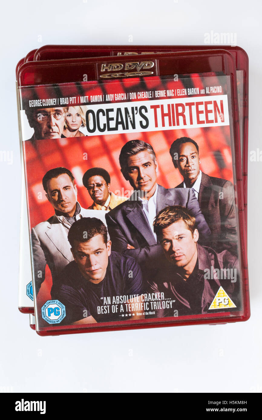 pile of HD DVDs with Ocean's Thirteen HD DVD on top set on white background - Stock Image
