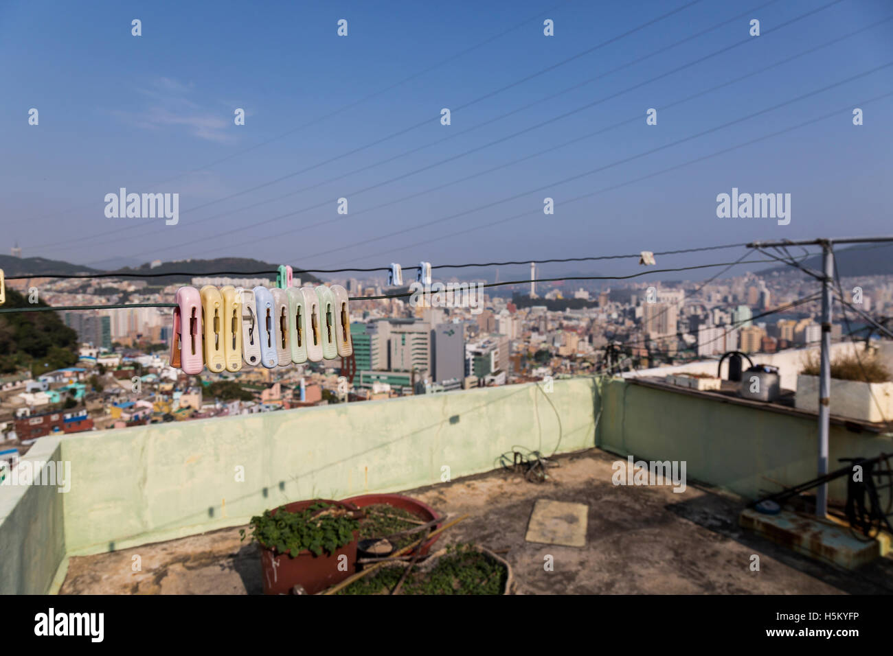 Cloths ping hanging on a rooftop in Busan, South Korea - Stock Image