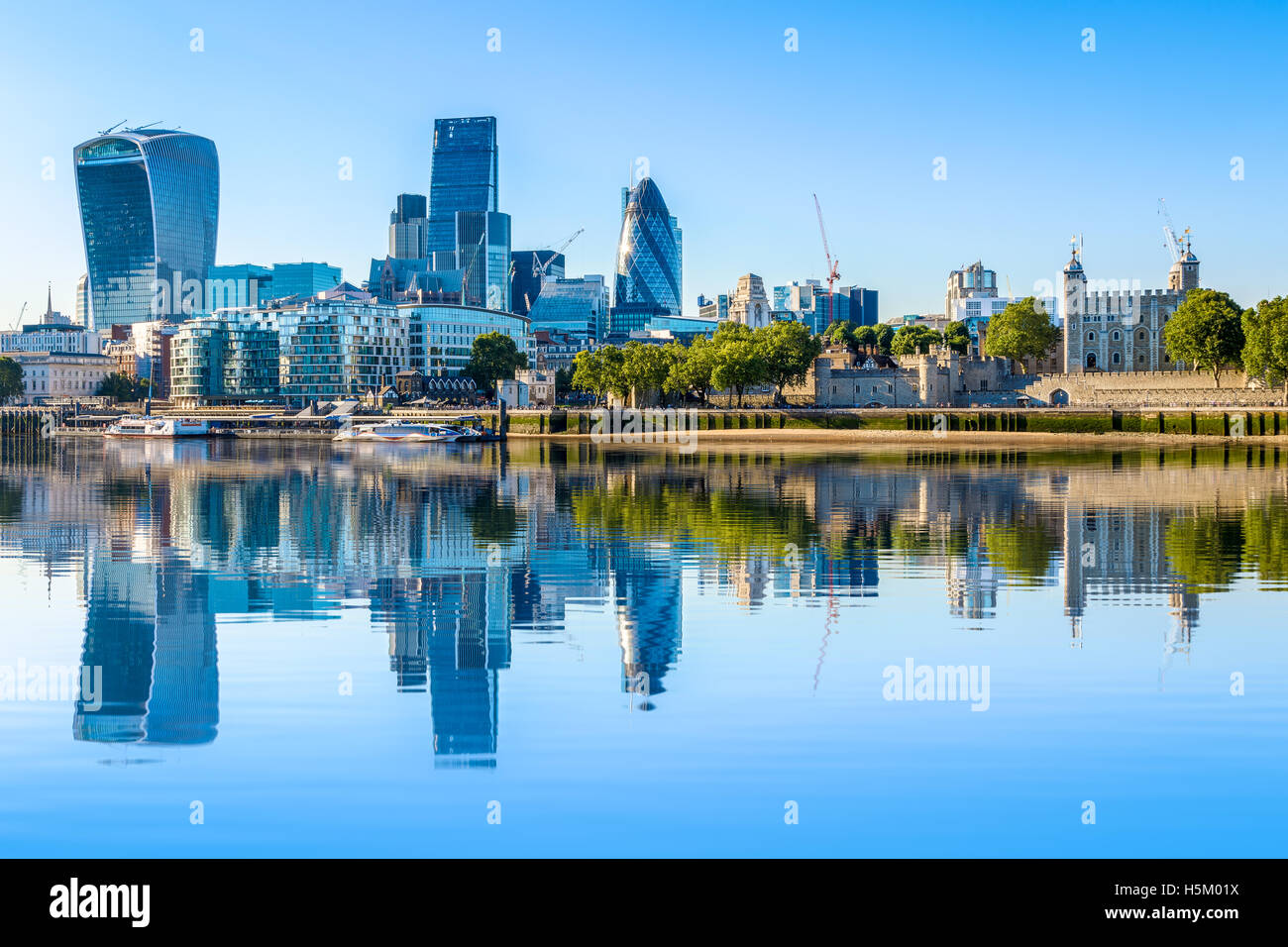 Cloudless day at financial district of London, including The Gherkin, Fenchurch building and Leadenhall building - Stock Image