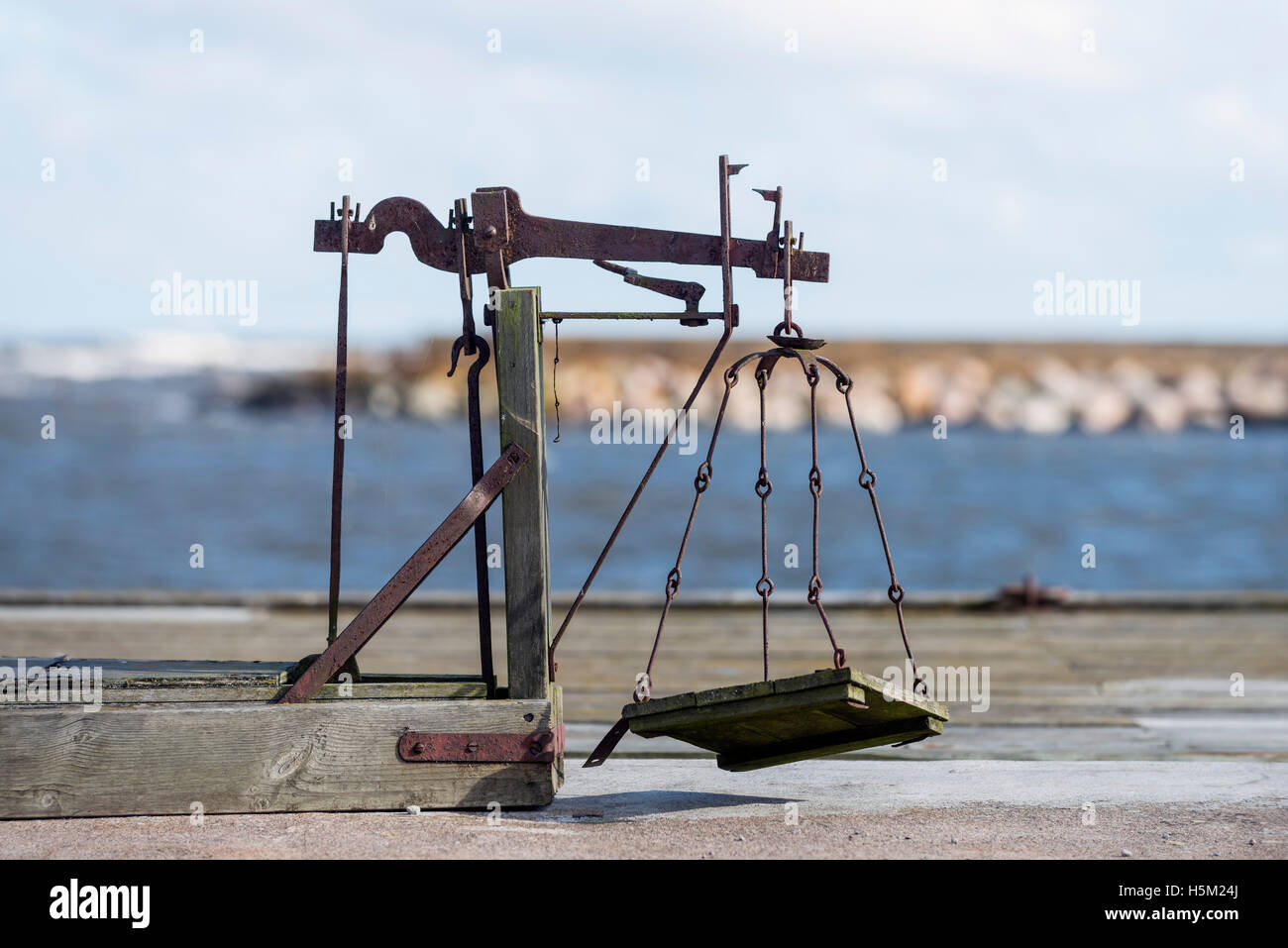 Old scale in fishing harbor. Öland, Sweden - Stock Image