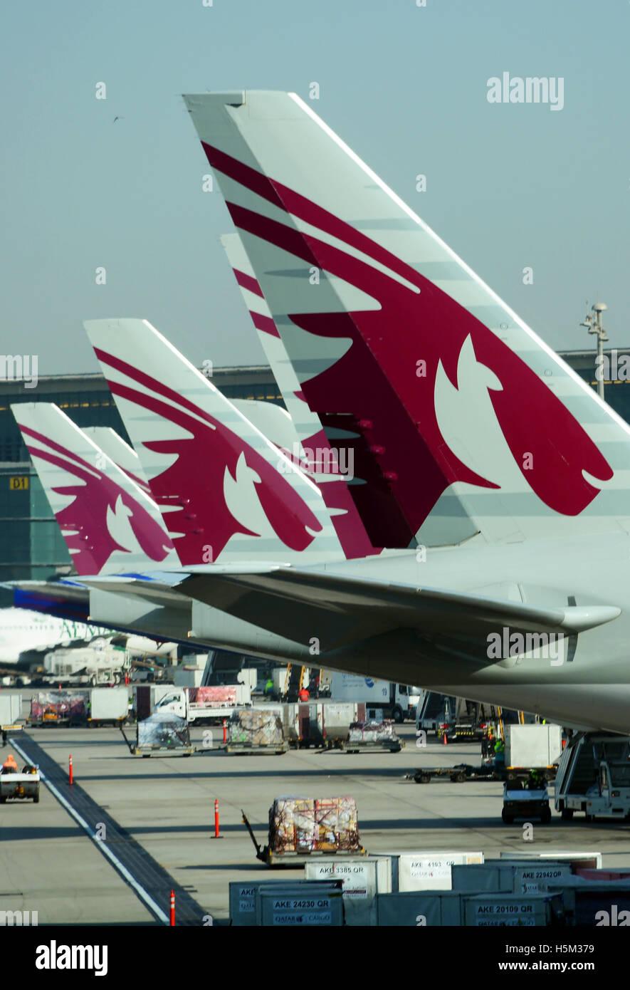 tails of Qatar airplanes Hamad Doha international airport - Stock Image