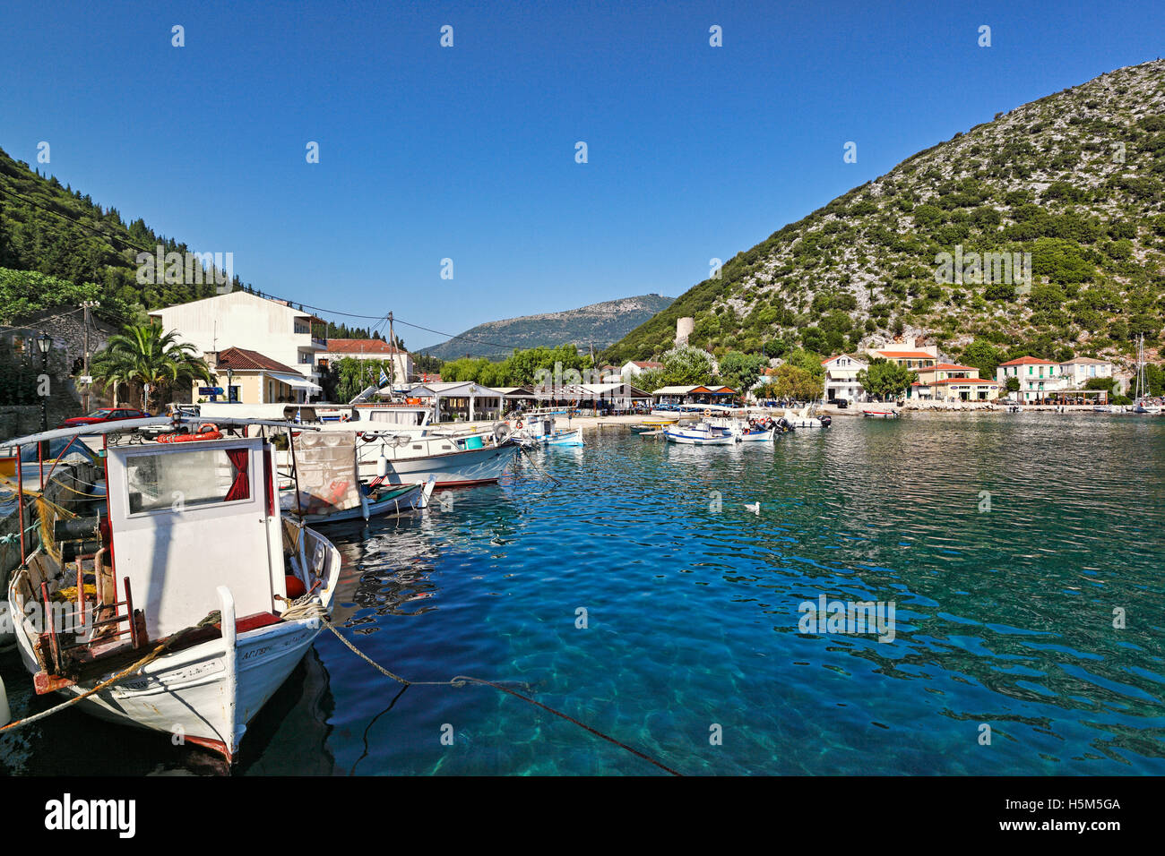 Fishing boats at the port of Frikes in Ithaki island, Greece - Stock Image