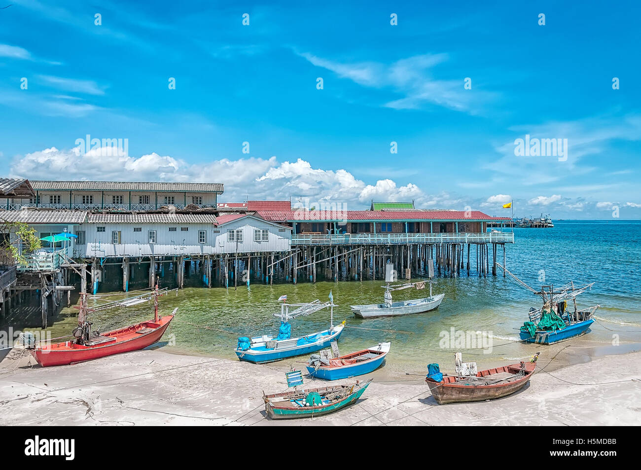 A cluster of fishing boats berthed at hua hin harbor in Thailand. - Stock Image