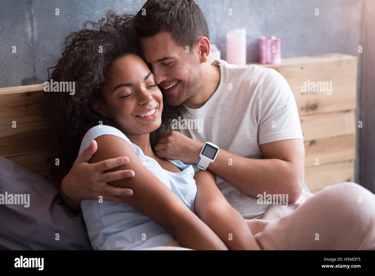 Delighted Couple Hugging Each Other In Bed