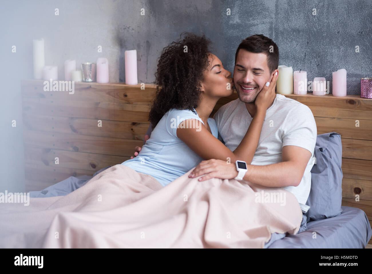 Beautiful Girl Kissing Her Boyfriend In Bed