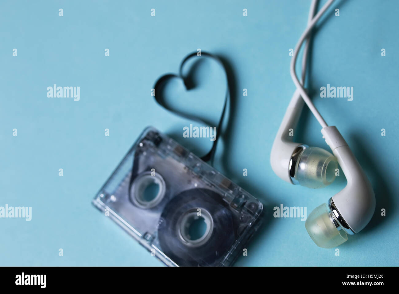 audio tape on a blue background - Stock Image