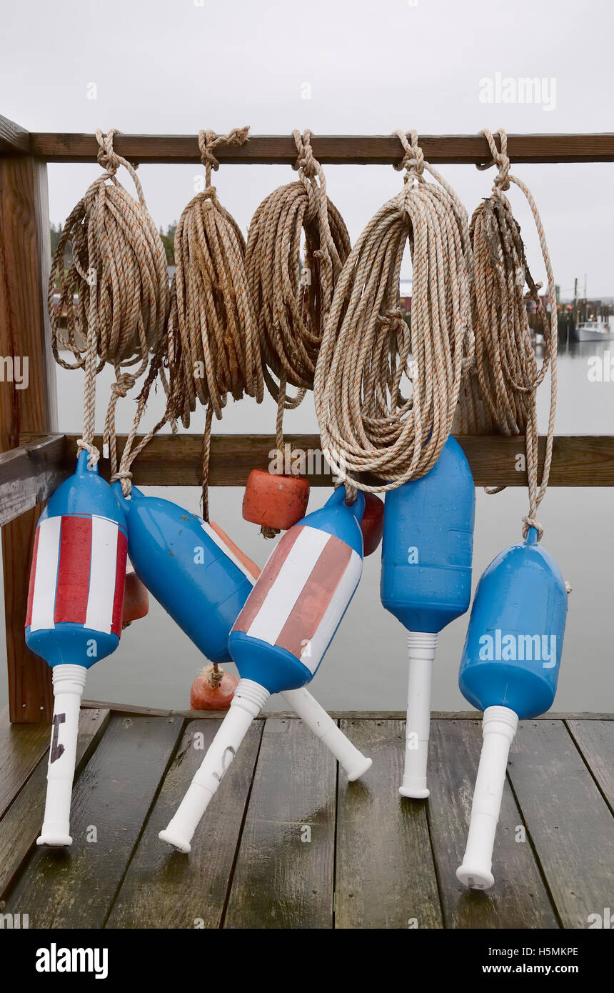 Lobster buoys and ropes. - Stock Image