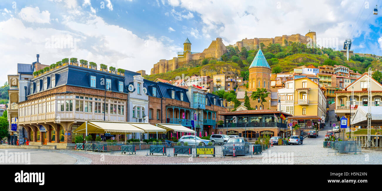 The Square of Vakhtang Gorgosali with numerous cozy cafes and bars, the dome of Armenian St George Cathedral, Tbilisi - Stock Image