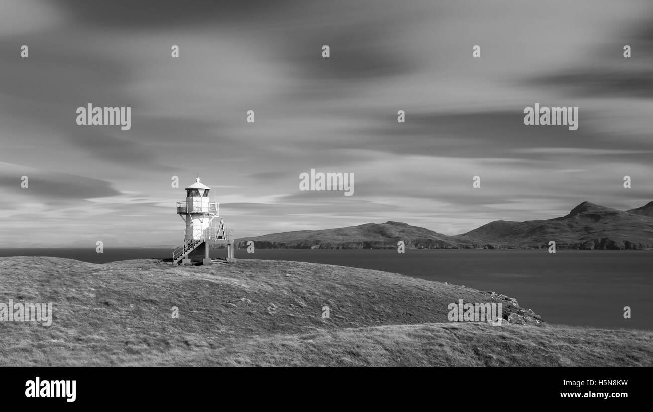 A lighthouse at Sanday Isle, Hebrides, Scotland - Stock Image