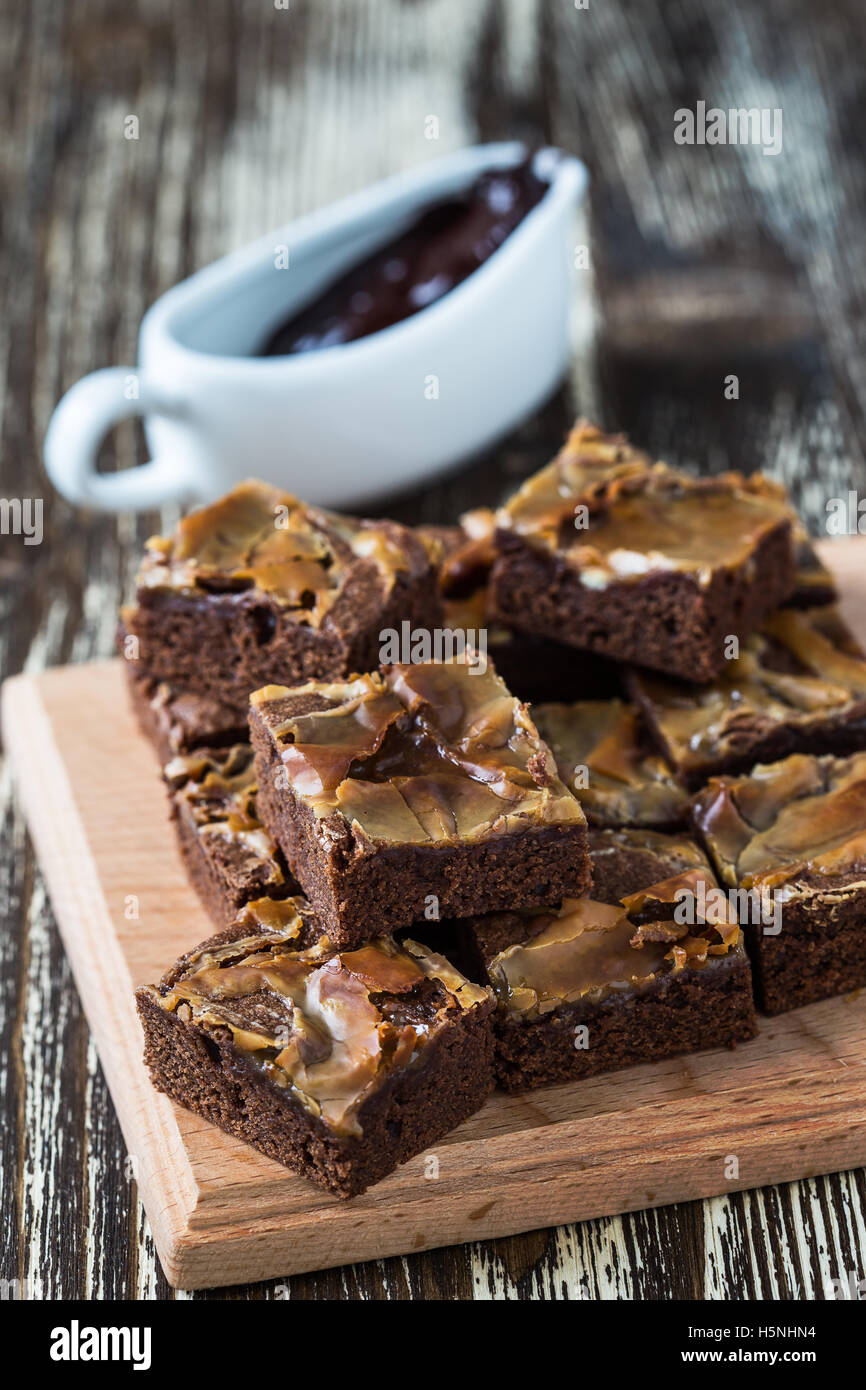Homemade caramel chocolate brownies on wooden board Stock Photo
