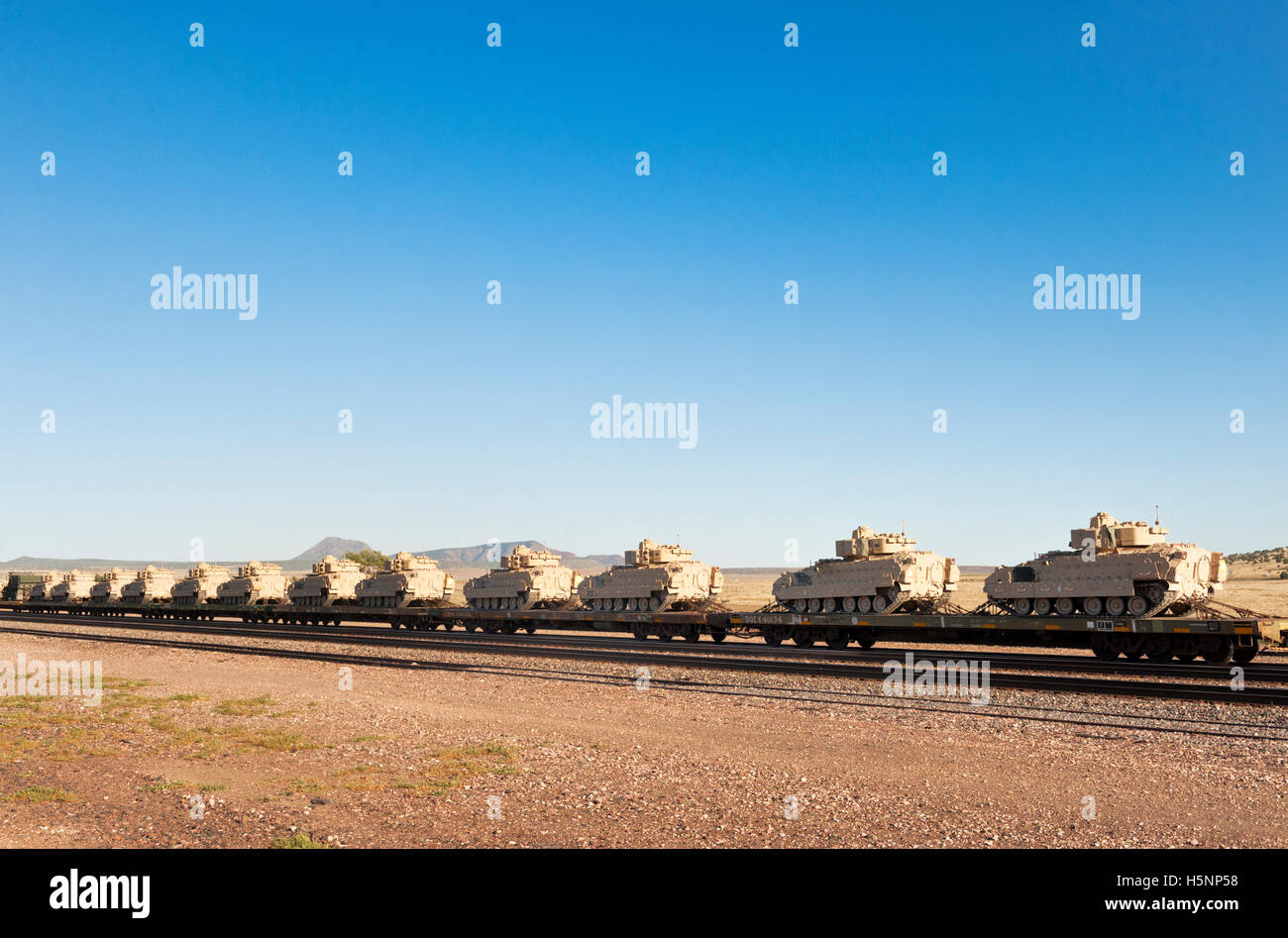 Military Armored Tank Vehicles on a Train in Northern Arizona - Stock Image