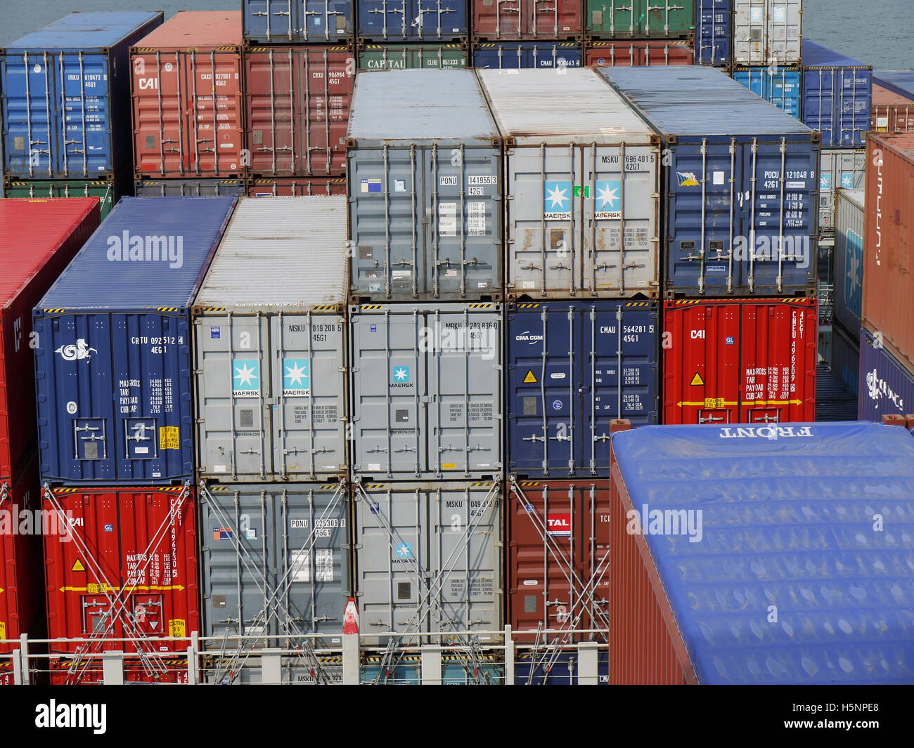 Containers on the deck of a ship ready for travel from Europe to China - Stock Image