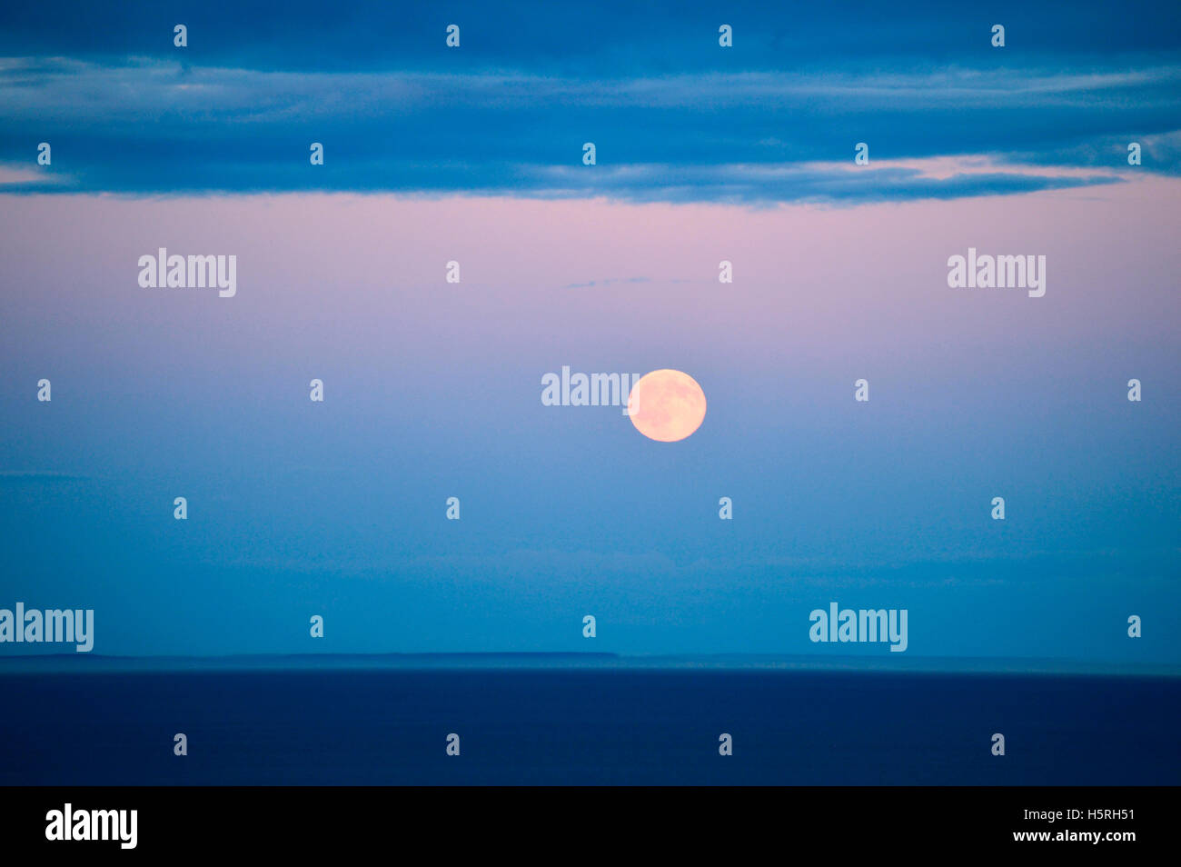 Full moon rising over the San Juan Islands, photographed from Victoria, British Columbia, Canada Stock Photo
