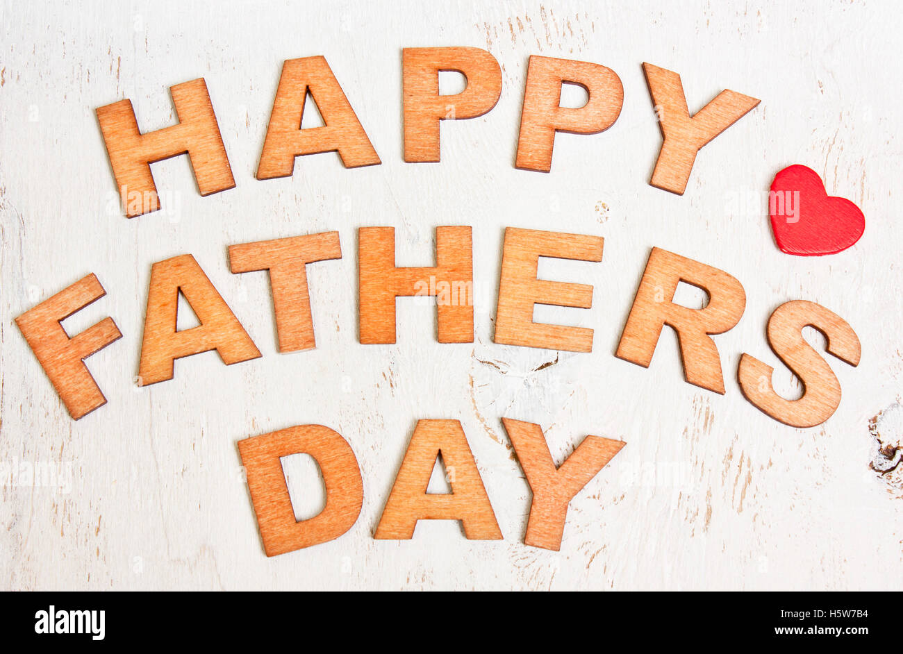 happy fathers day with wooden letters on an old white wooden background