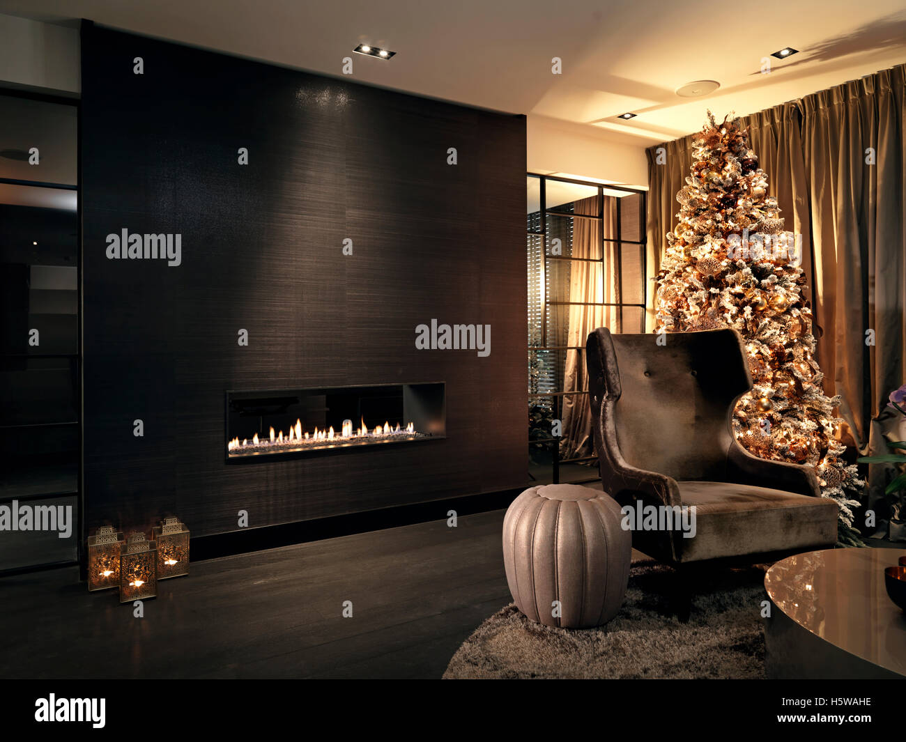 Christmas tree in livingroom with fireplace - Stock Image