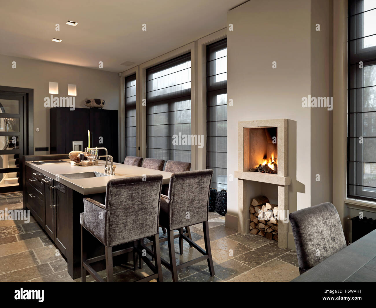 Fireplace in kitchen with table - Stock Image