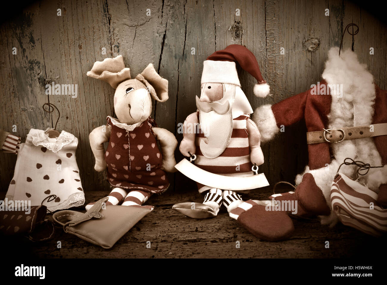 Santa Claus and Rudolf, old rag dolls on wooden background for Christmas Cards - Stock Image